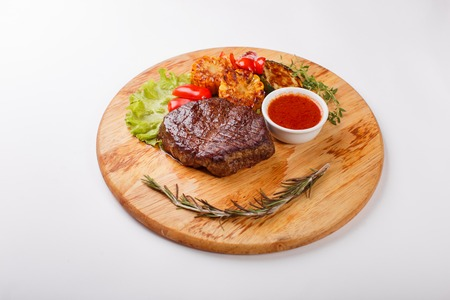 angus: Steak on cutting board on wooden black rustic background