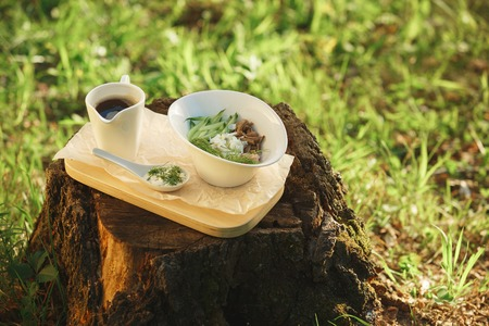salad in white salad bowl on a background of nature top vew
