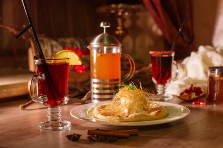 Glass of hot apple tea on christmas background