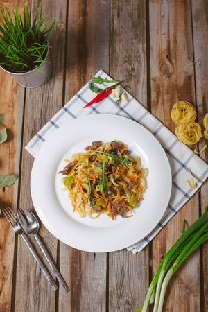 Spaghetti with Vegetables, Ham, Black Olives, Rucola and Pesto Sauce Stock Photo