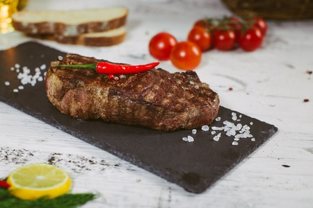 Grilled 500g bbq steak on wooden table