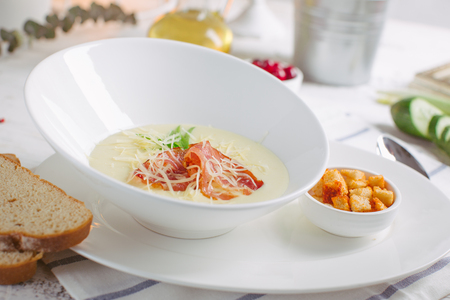 Cheese soup with roast bacon, herbs and spices