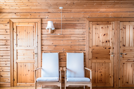 Pinewood Interior Wall Armchairs And Doors Cabin Cottage Stock