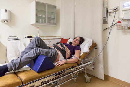 maternity ward: Pregnant woman in hospital acute ward. Stock Photo