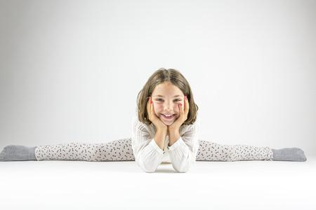 splits: Girl leans forward in splits.