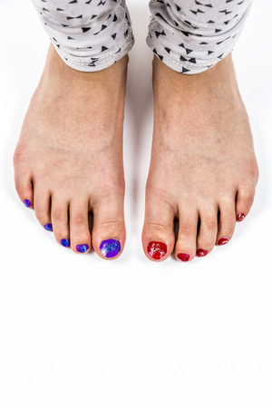 painted toes: Young girls feet, toes with nail polish.