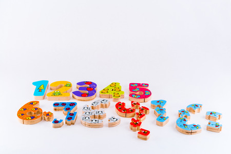Scattered wooden toy figures one to ten, jigsaw puzzle pieces. Stock Photo