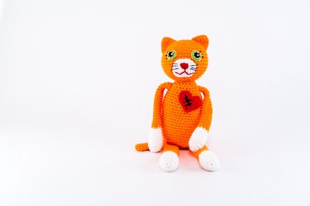cuddly toy: Broken heart with scar, stuffed toy cat. Horizontal isolated on white.