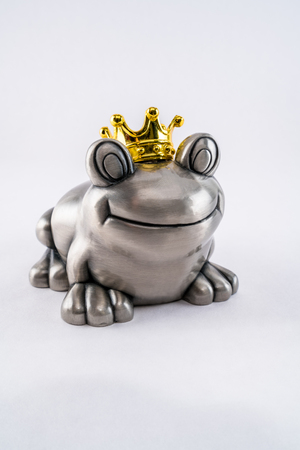 Valentine prince frog with gold crown, waiting for princess. Stock Photo
