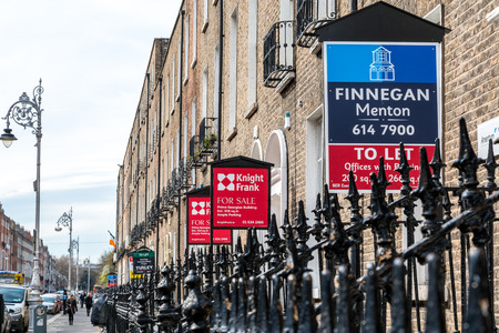 brokerage: Brokerage signs for sale, apartments and offices.  Dublin city, Ireland - April 21, 2016: Several brokerage signs in a row outside apartments, offices. Brokerage signs, for sale, to let. Editorial