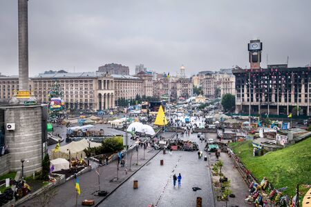 incidental people: View over Maidan Nezalezhnosti, Kiev.  Maidan Nezalezhnosti, Kiev. Maidan Nezalezhnosti, Kiev, Ukraine - May 15, 2014: View from the hill overlooking Maidan Nezalezhnosti, May 15 , 2014.