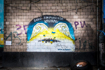 wall mural: Protest painting on wall Kiev Ukraine May 15, 2014.. Freedom protest wall painting, Kiev Ukraine.  Maidan Nezalezhnosti, Kiev, Ukraine - May 15, 2014: Wall, mural, protest painting Kiev Ukraine.