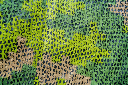 Green military camouflage net with different shades.