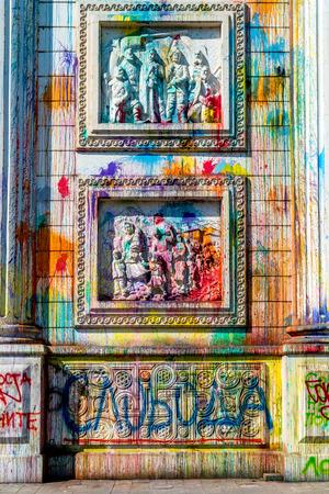 manifestation: Vandalism of the triumphal arch in Skopje. Skopje, Macedonia - September 24, 2016: Splashes of color on Porta Macedonia, the triumphal arch in the center of Skopje. Color traces after manifestation. Editorial