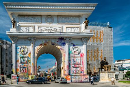 Vandalism on the triumphal arch in Skopje. Skopje, Macedonia - September 24, 2016: Splashes of color on Porta Macedonia, the triumphal arch in the center of Skopje. Color traces after manifestation.