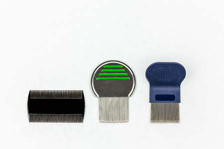 nit: Three different kinds of lice combs. Studio shot on white background with copy space. Stock Photo