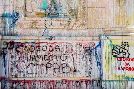 vandalism: Vandalism and graffiti on building landmark. Skopje, Macedonia - September 24, 2016: Triumphal arch, Porta Macedonia vandalized with paint and graffiti. Protest writings on public landmark building.