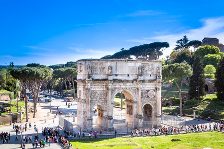 constantin: The Arch of Constantine, Rome. Rome, Italy - April 22, 2015: Ancient triumphal arch of Constantin in Rome.  High angle view to show the arch and surrounding square with trees. Tourist around the arch.
