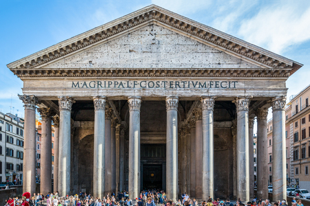 Pantheon In Rome with tourists. Rome, Italy - April 22, 2015: Tourists outside visiting ancient building Pantheon in Rome. Outside, front view wide angle with tourists in lower section of the image. Editorial