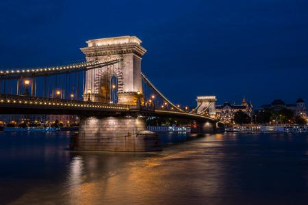 Beautiful night shot of the illuminated Chain Bridge in Budapest across the Danube river in Hungary. Stock Photo - 88170018