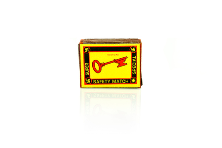 A vintage match box with a key  on the front. Isolated studio shot on white background. Stock Photo - 90494539