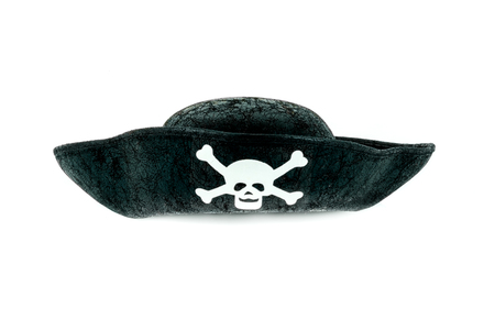 Isolated black vintage pirate hat with a skeleton skull, studio shot on white background. Stock Photo