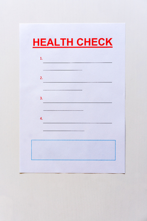 A blank health check form with text and lined copy space. Stock Photo - 90799448