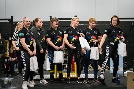 STOCKHOLM, SWEDEN - JANUARY 13, 2018: Six Swedish female armwrestlers getting a price at the award ceremony during the event Arm Battle of Sweden outside of Stockholm January 13, 2018. Editorial