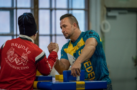 STOCKHOLM, SWEDEN - JANUARY 13, 2018: Two Swedish male arm wrestlers training in a friendly match during the event Arm Battle of Sweden outside of Sockholm January 13, 2018.