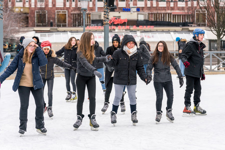 STOCKHOLM, SWEDEN - FEBRUARY 03, 2018: Front view of several happy young woman skating at a public ice skating rink outdoors in the city center of Stockholm february 03, 2018. Incidental people in the background. Stock Photo - 98937215