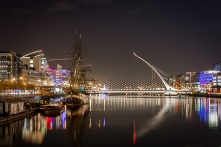 Beautiful night view of Dublin with water, bridge and buildings. Stock Photo