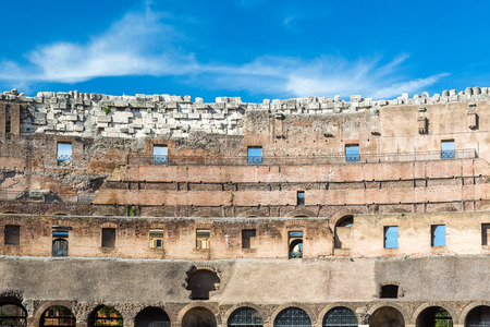 Ancient wall of the Colosseum in Rome Italy. Stock Photo - 98937920