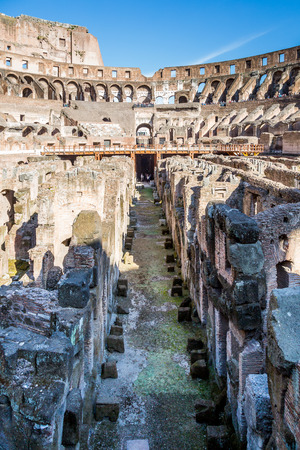 ROME, ITALY - APRIL 22, 2015: Vertical ground view of the center aisle inside the Colosseum in Rome April 22, 2015. Stock Photo - 98937922