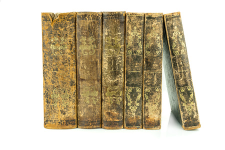 Six aged ancient old leather books standing, studio shot on white. Stock Photo
