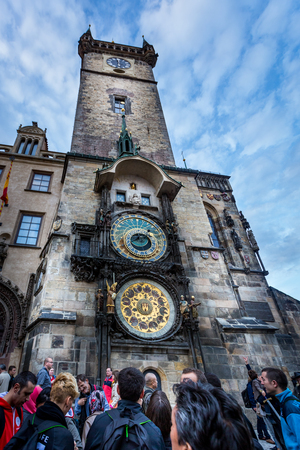 PRAGUE, CZECH REPUBLIC - SEPTEMBER 25, 2014: Ground view of a group of people outside the astronomical clock tower in Prague September 25, 2014. Editorial
