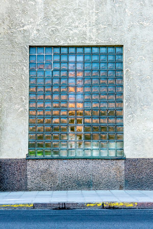 Front view of one large mosaic window on a city building. Stock Photo