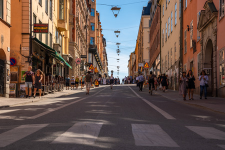 STOCKHOLM, SWEDEN - MAY 26, 2018: Low angle view of people walking on a city shopping street in Stockholm Sweden May 26, 2018. Editorial