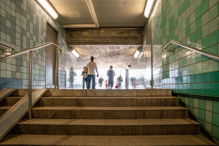 STOCKHOLM, SWEDEN - MAY 26, 2018: Low angle view of people passing throgh a subway underpass in Stockholm Sweden May 26, 2018.