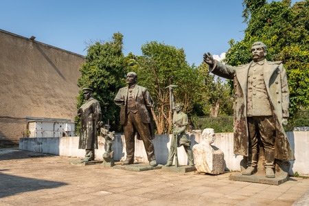 Old worn Soviet statues hidden away in a public park in Tirana Albania. Eastern Europe culture.