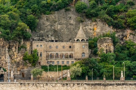 Front view of the beautiful old stone church at Gellért Hill Cave i Budapest Hungary. Stock Photo