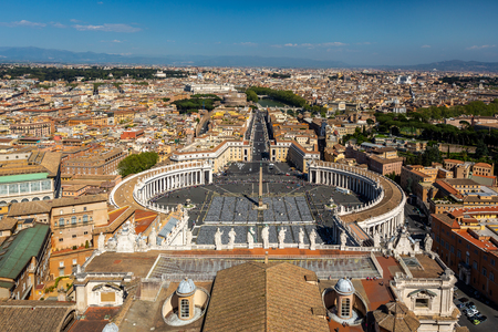 ROME, ITALY - APRIL 21, 2015: Aerial view of the Vatican state and S:t Peter´s square with the city of Rome in the background in Rome Italy April 21, 2015. Editorial