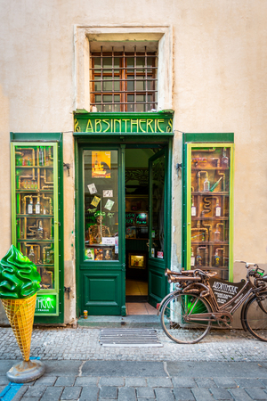PRAGUE, CZECH REPUBLIC - SEPTEMBER 28, 2014: Front street view of a green decorative liquor store selling absinthe beverage in the old town of Prague Czech Republic September 28, 2014.