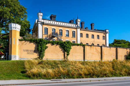 VISBY, SWEDEN - JULY 27, 2020: Facade view of the famous yellow landmark building Sjumastarn. An old prison building now used as a hostel in the city of Visby Gotland Sweden July, 2020. Editorial