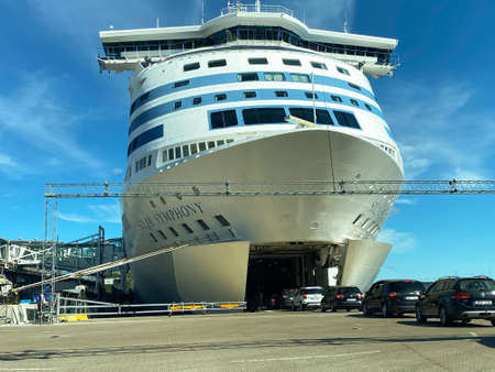 STOCKHOLM, SWEDEN - JULY 26, 2020:  Close front view of many cars entering the bow of the Tallink Silja Line cruise ship ferry moored in the port of Vartahamnen, Stockholm Sweden July 26, 2020.