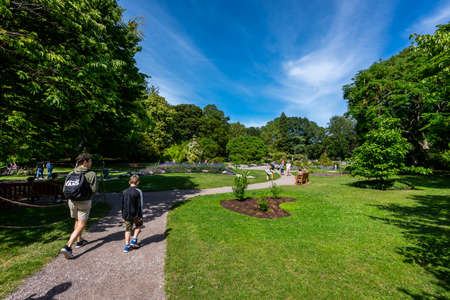 VISBY, SWEDEN - JULY 27, 2020: Beautiful summer landscape view of people walking and relaxing in a recriation park area in the city of Visby Gotland Sweden July 27, 2020.