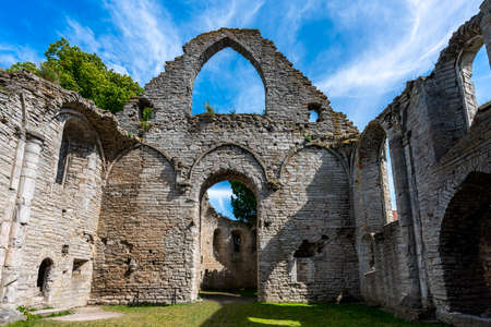Summer, inside interior architecture of an ancient medieval church ruin with blue sky in Visby Gotland Sweden. Historical ruins with free entry.