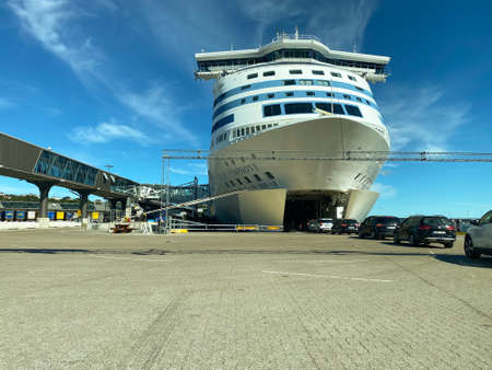 STOCKHOLM, SWEDEN - JULY 26, 2020:  Wide front view of many cars entering the bow of the Tallink Silja Line cruise ship ferry moored in the port of Vartahamnen, Stockholm Sweden July 26, 2020.