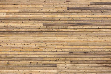 Background with many natural rustic pinewood plank timber on exterior outdoor  wall.