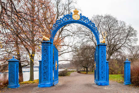 Beautiful vintage blue steel iron gate entrance to the public park Djurgarden in Stockholm Sweden. Stock Photo