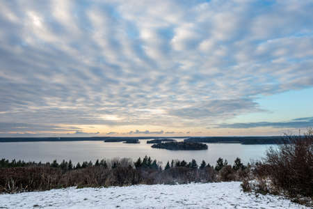 Beautiful winter sunset landscape view of water, islands, sky and horizon in the Stockholm archipelago.